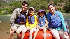 Portrait of happy Caucasian family enjoying rafting on Colorado River on holiday - stock footage