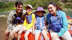 Portrait of happy American Caucasian family rafting on Colorado River on holiday - stock footage