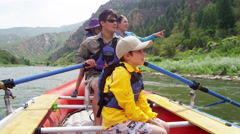 Happy American parent and children enjoying rafting on Colorado River outdoors - stock footage