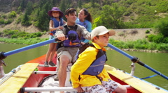 American Caucasian family rafting together on Colorado River on vacation outdoor - stock footage