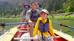 American Caucasian family rafting on Colorado River on vacation outdoors - stock footage