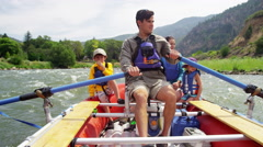 Confident American family rafting on Colorado River on vacation outdoors - stock footage
