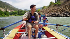 Happy Caucasian family rafting on Colorado River on vacation outdoors Stock Footage