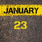 Stock Photo of 23 January calendar day over road marking yellow paint line