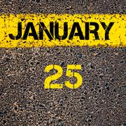 25 January calendar day over road marking yellow paint line Stock Photos