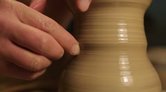 Hands of a potter, creating an earthen jar on the circle Stock Footage
