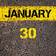 Stock Photo of 30 January calendar day over road marking yellow paint line