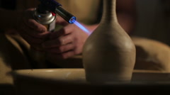 hands of a potter, creating an earthen jar on the circle - stock footage