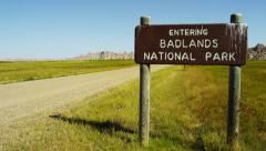 South Dakota Badlands National Park sign Landscape buttes USA - stock footage