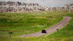 Dakota Badlands view of vehicle driving desert Buttes USA Stock Footage