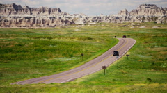 Car driving Dakota Badlands desert Buttes USA Stock Footage