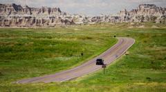 Dakota Badlands view of vehicle driving desert Buttes USA - stock footage