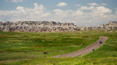 Vehicle drive in Badlands National Park sandstone Buttes Stock Footage