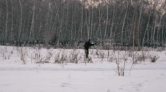 Man riding on skis in the woods. Slow motin Stock Footage