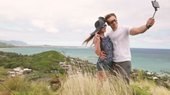 Stock Video Footage of Happy couple taking selfie self-portrait photo hiking, Oahu, Hawaii