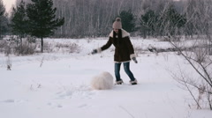 Girl jumping and running with a dog in winter park. Slow motin Stock Footage