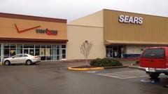 Pan of Verizon and Sears Stores Facades Stock Footage