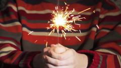 hand holding a burning sparkler - stock footage