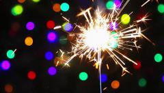 burning sparklers on the background of the Christmas illuminations - stock footage