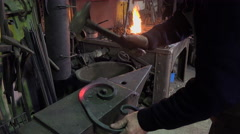 Blacksmith in his workshop Stock Footage