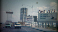 Stock Video Footage of 1965: TWA Jets road travel advertisement sign Caesars Palace Dunes Casino.  LAS