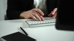 Focused man working at a computer Stock Footage