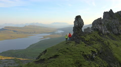 Aerial view of couple hill walking Totternish Ridge Skye Scotland Stock Footage