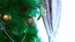 Christmas decorations and toys on pine Stock Footage