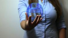 Woman holds Volleyball hologram for presentation Stock Footage