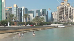 Bathing people with Corniche on background Stock Footage