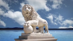 Stock Video Footage of Bridge of Lions Monument in St. Augustine by the Water with Clouds in Time Lapse