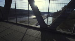 movement bridge in slow motion background with river and sun - stock footage
