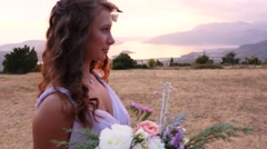 The bride and groom posing on the sunset Stock Footage