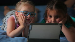 Girls watching a cartoon on the tablet Stock Footage