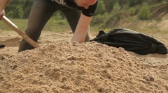 man digging a hole with a shovel. Close-up. Stock Footage