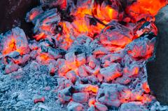 Glowing embers campfire closeup Stock Photos