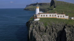 Aerial view Neist Lighthouse people hiking Skye Stock Footage