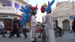 Men selling balloons at souq Waqif Stock Footage