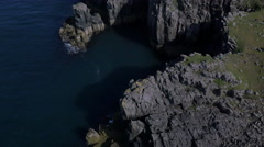 Aerial view of people Neist Lighthouse Scotland Stock Footage
