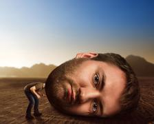 Man with enormous head - stock photo