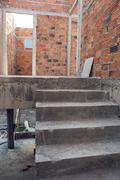 staircase cement concrete structure and brick wall in residential house build - stock photo