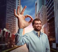 Man showing ok-sign - stock photo