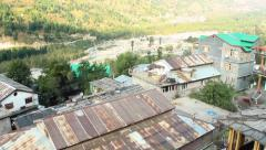 Village of Vashisht  in Himalayan region Uttar Pradesh aerial panning shot Stock Footage