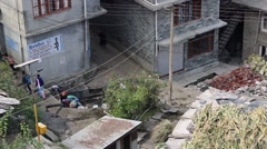 Women wash their clothes in common washing area in Vashisht, India Stock Footage