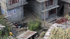 Women and men wash their clothes in common washing area in Vashisht, India Stock Footage