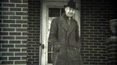 1936: Man backing car out of driveway in Ford 1934 model vehicle. SAXTON, Stock Footage