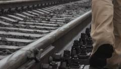 A man walking on railroad tracks. along the tracks Stock Footage