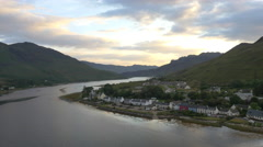 Aerial dusk view of Dornie village Loch Duich Scotland Stock Footage