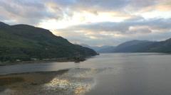 Aerial dusk view Eilean Donan castle Loch Duich Scotland Stock Footage