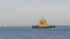 Tugboat on route in port harbor Stock Footage